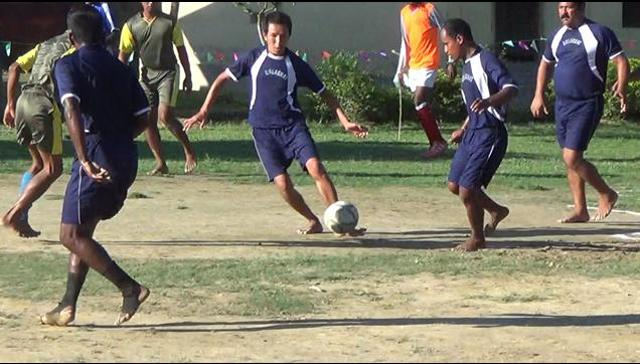 Inmates of the Golaghat district jail play football inside the jail premises. (HT)