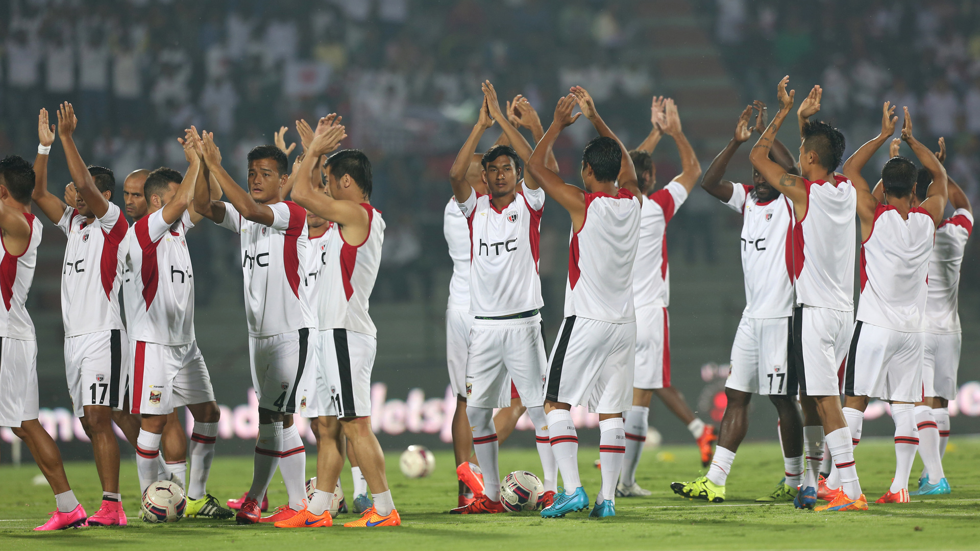 NorthEast United FC Players waves towards the crowd during the warm up session before the match 38 of the Indian Super League (ISL) season 2 between NorthEast United FC and Kerala Blasters FC held at the Indira Gandhi Stadium, Guwahati, India on the 15th November 2015. Photo by Deepak Malik / ISL/ SPORTZPICS