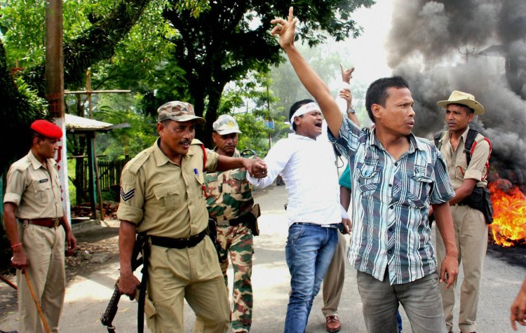 Margherita: Asom Jatiyatabadi Yuva Chatra Parishad (AJYCP) including 11 other organizations protesting against Centre's decision to grant citizenship to non-Muslim immigrants, at Margherita in Tinsukia, Assam on Saturday. PTI Photo (PTI9_12_2015_000145B)