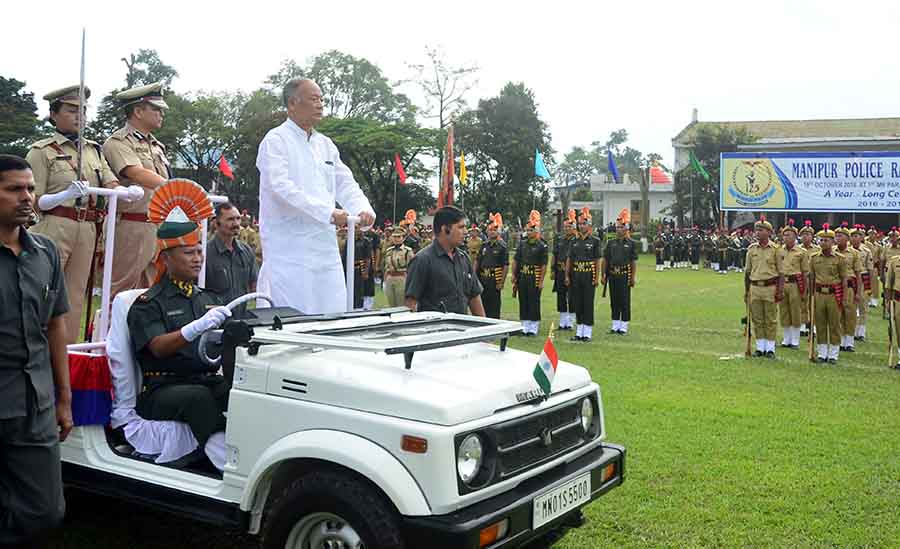 Okram Ibobi inspects guard of honour during the observance of the 125th Raising Day Parade of Manipur Police