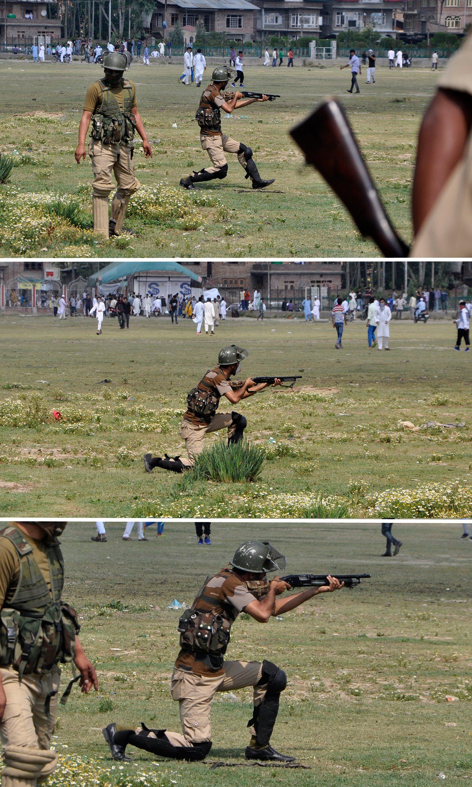 An Indian policeman aims a pellet gun towards Kashmiri protesters in Srinagar in July. Composite: Syed Shahriyar/Syed Shahriyar/NurPhoto via Getty Images