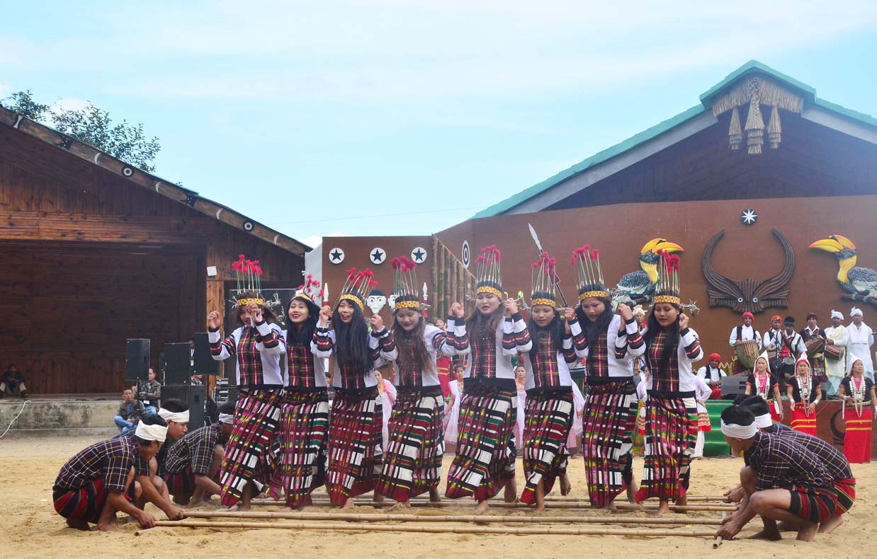 Artist from Mizoram perform a bamboo dance on the second day of the state annual Hornbill Festival at Naga Heritage village Kisama, some 15 kms away from Kohima, Nagaland on Friday, December 02, 2016. Photo by Caisii Mao