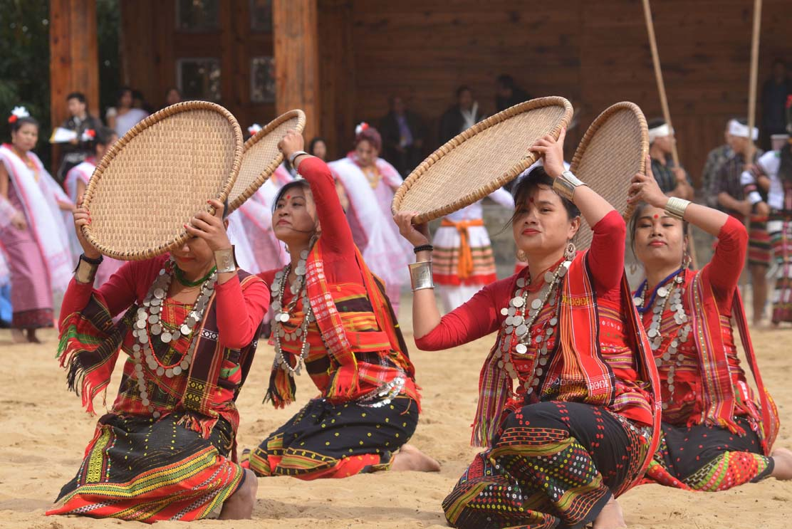 Artist from Tripura perform a cultural dance on the second day of the state annual Hornbill Festival at Naga Heritage village Kisama, some 15 kms away from Kohima, Nagaland on Friday, December 02, 2016. Photo by Caisii Mao