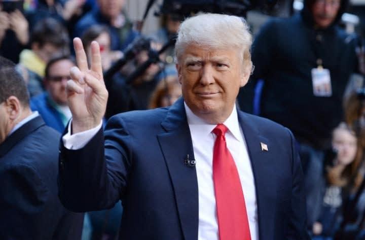 Donald Trump regularly flashes a peace sign at cameras Credit: Rex