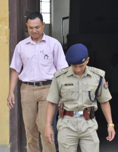 The accused police commando personnel in connection of killing Th. Sanjit on July 23 2009 being escorted by a police officer at CJM Imphal Cheirap court on Monday. Photo: K. Bipin Sharma, Imphal