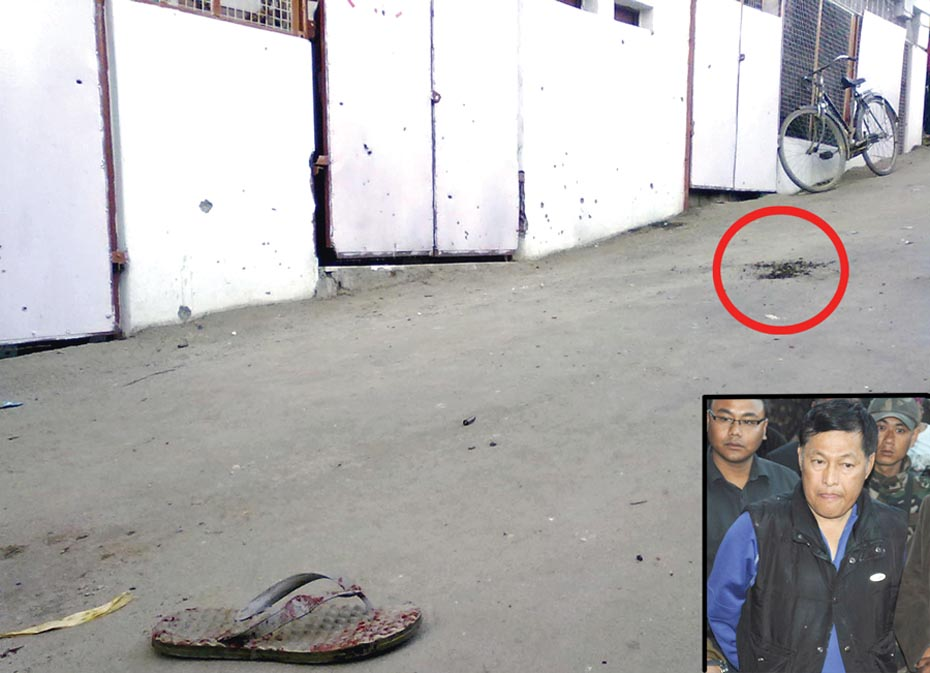 A blood stained slipper lying near the cavity created by the bomb blast (encircled in red). inset: Chogtham Ranabir, Executive engineer IFCD Flood Control division no 1 speaking to media persons. 2011-02-11 | by : IFP Photo