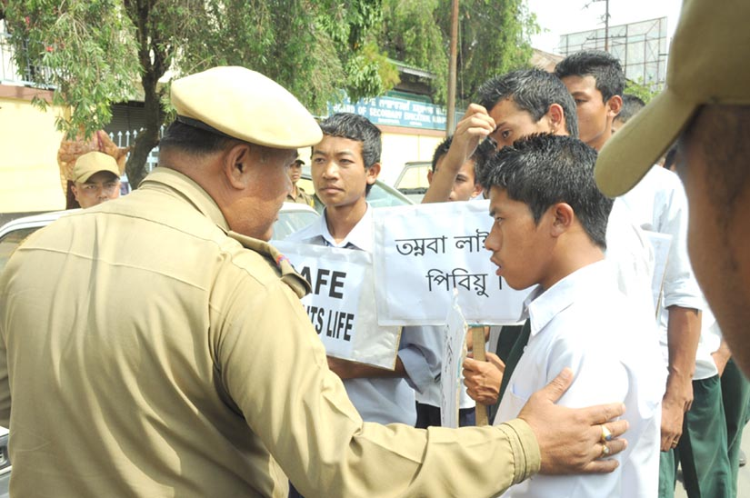 Police personnel trying to pacify the agitating students who came to gheraoed the Board office today.