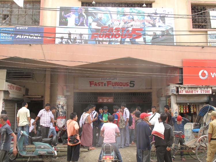 Cinema goers inquiring about the ticket price from the black marketeers during the first day showing of the Hollywood flick, Fast & Furious after the decade long lull at the Usha cinema hall in the heart of Imphal.