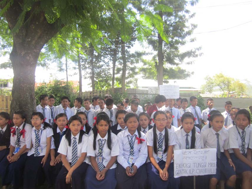 Students staging sit-in-protest demanding implementation of Inner Line Permit System in Manipur on Monday