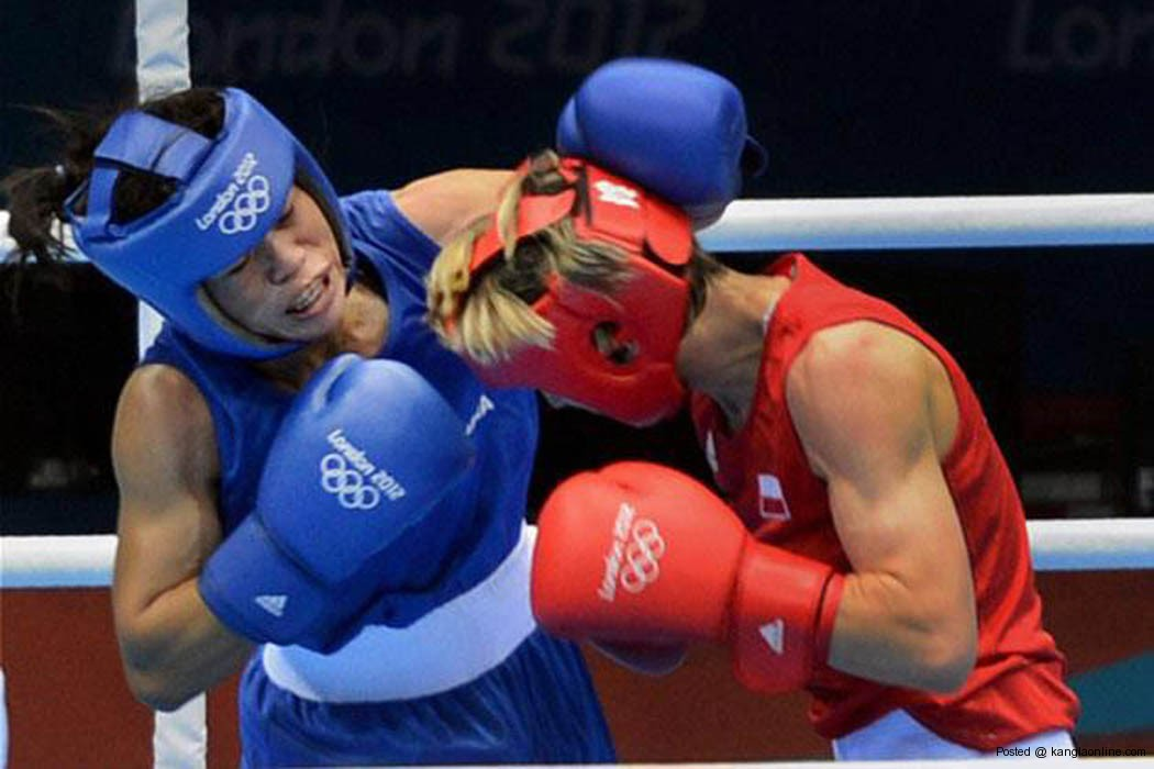 India's Mary Kom (blue) plays against Poland's K Michalczuk at Women's Fly 51kg during the 2012 Olympic Games in London on Sunday. Mary Kom entered the quarterfinals.