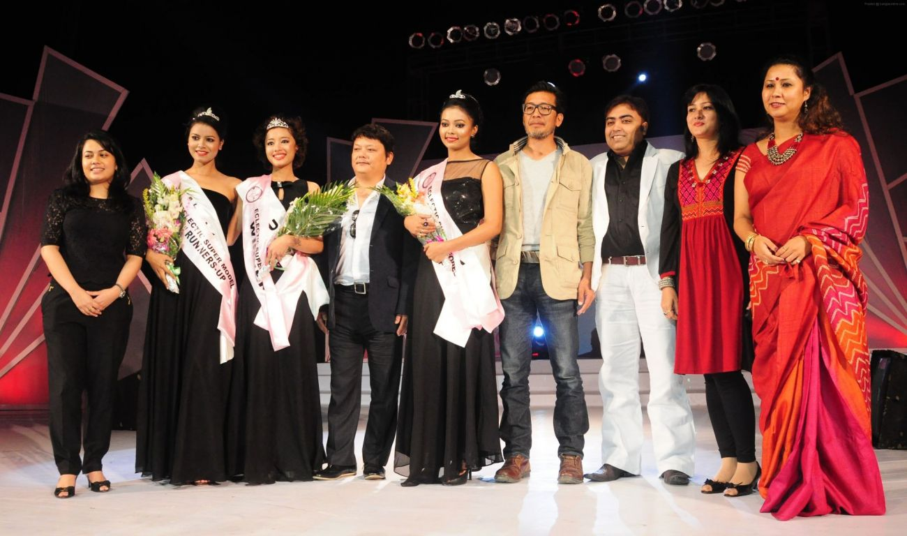 Winners posing with the judges