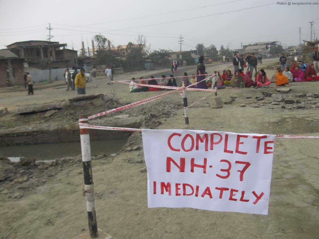 Locals staging a road block at Sagolband along the NH 37 on Tuesday.