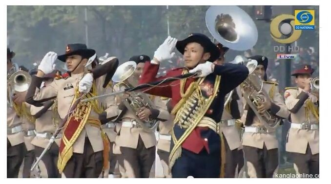 Manipur Native, Varun Nepram (in red dress and holding staff), leading the Boys' NCC Band Contingent at the 65th Republic Day Celebrations, 2014 (photo courtesy: Doordarshan)