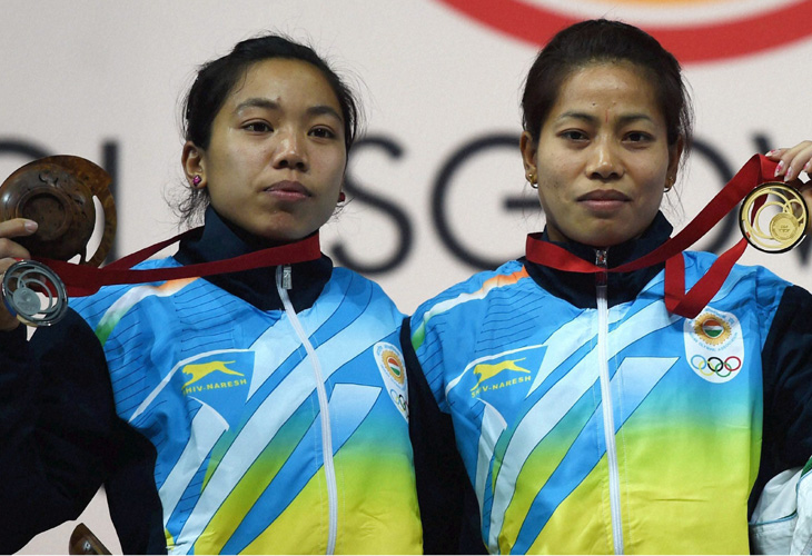 Sanjita and Mirabai after winning Gold and Silver Medals in Glasgow commonwealth's Games 2014. Zee Media Bureau/ Suyash Srivastava