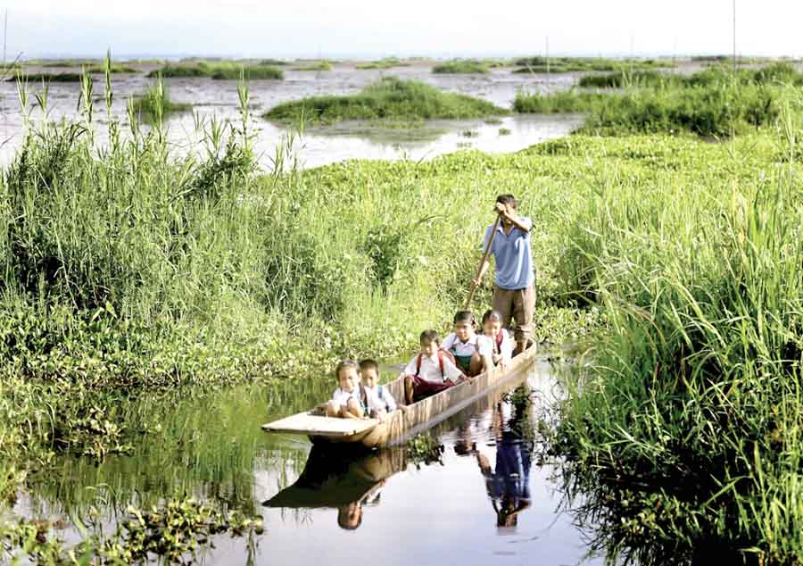 Students' coming to school by wooden boat from Karang Island to