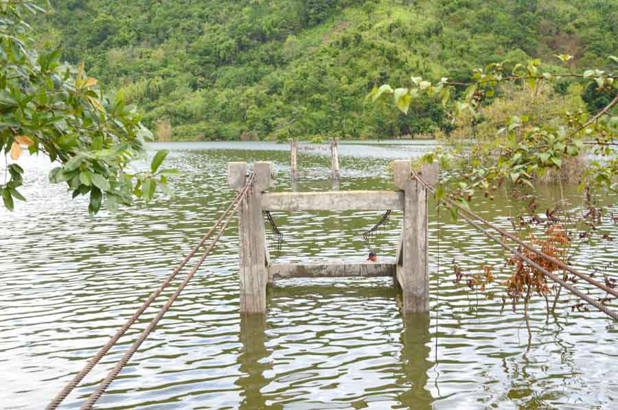 The bridge connecting Chadong village to other villages lay submerged in water.