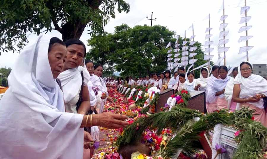 Participants offering floral tributes to June 18 martyrs during the observation
