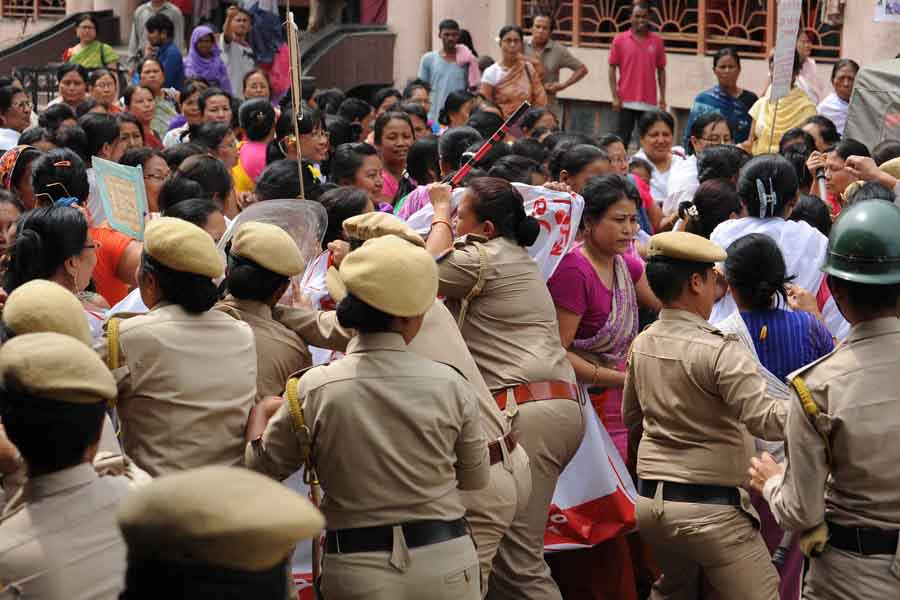 Police women trying to control vendors of Ima Keithels during a protest rally.