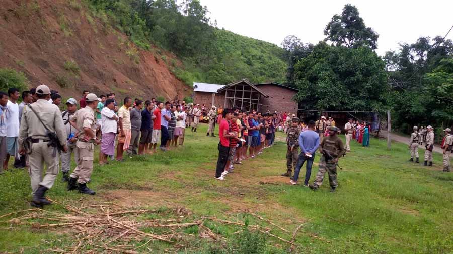 Locals of Saiton Bishnupur lined up for identification during the search operation on the eve of I-Day.