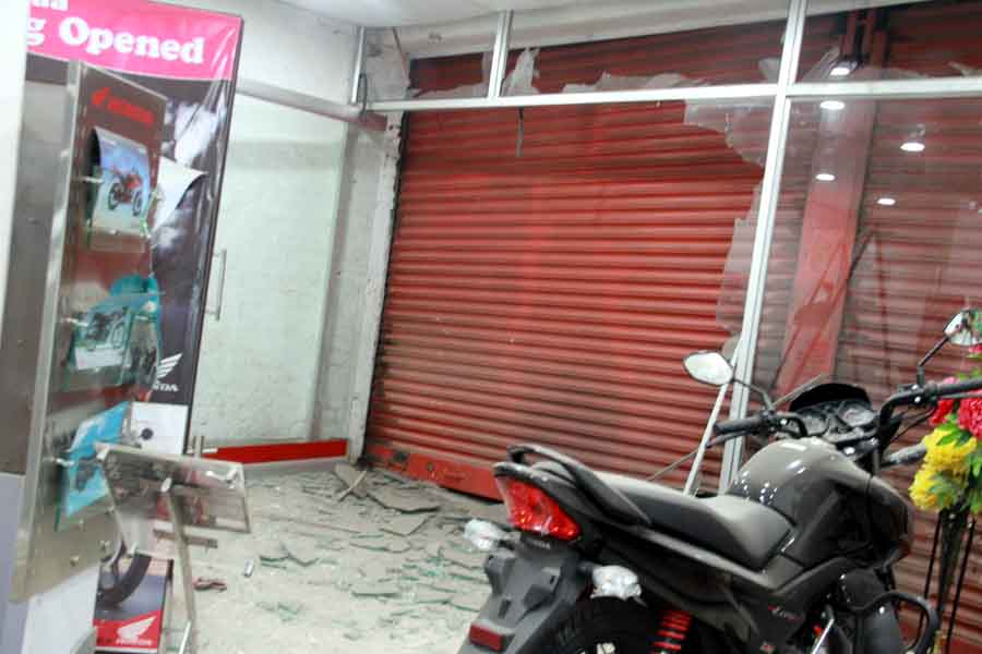 Blast damaged portion of Punya Hyundai showroom at Thangmeiband road opposite ABC godown. IFP Photo