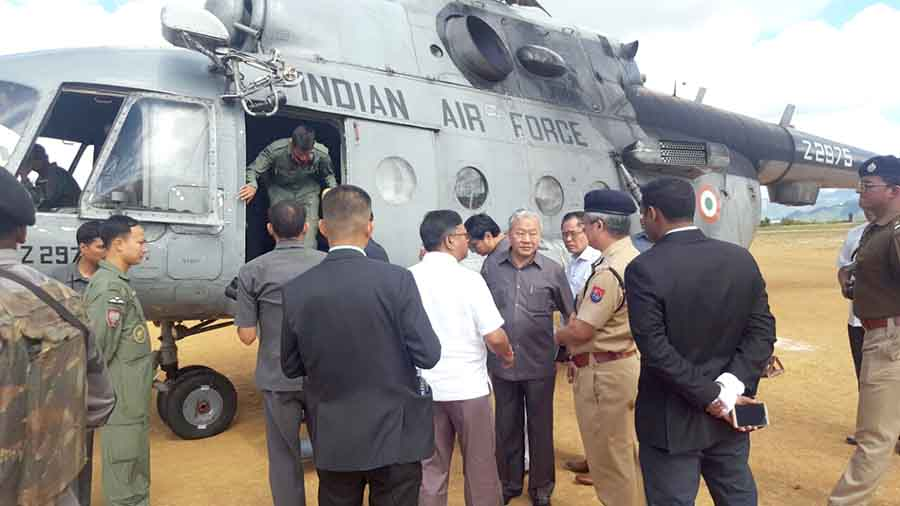 Deputy Chief Minister Gaikhangam and other ministers interact with police officials at the Ukhrul helipad