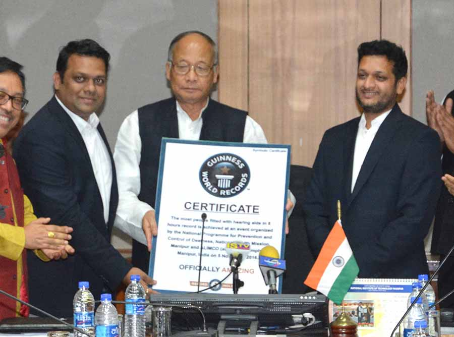 CM Ibobi receives the Guinness World Record Provisional Certificate or distribution of maximum number of hearing aids.