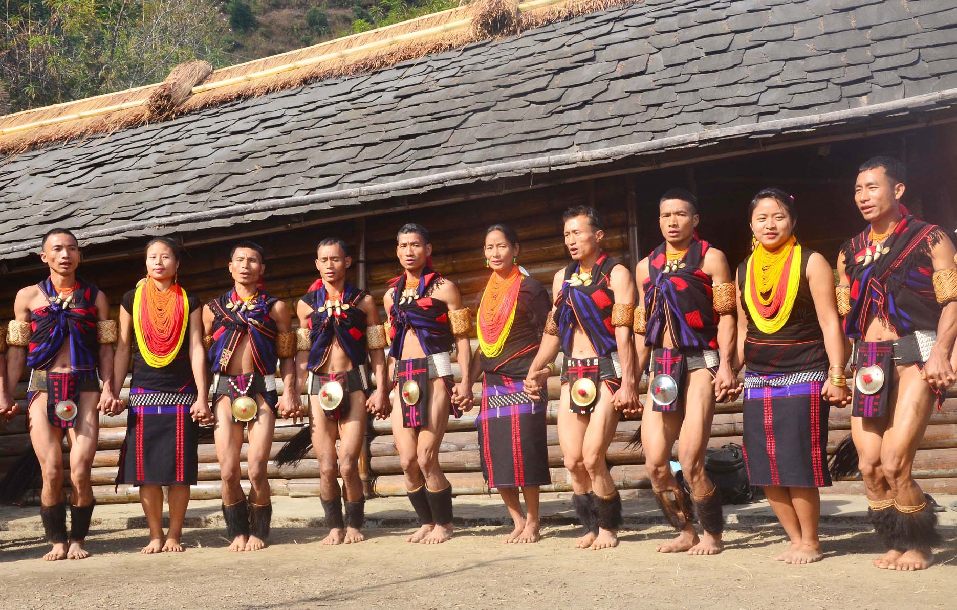 Naga tribesman perform a folk dance in front of their Morung on the second day of the state annual Hornbill Festival at Naga Heritage village Kisama, some 15 kms away from Kohima, Nagaland on Friday, December 02, 2016. Photo by Caisii Mao