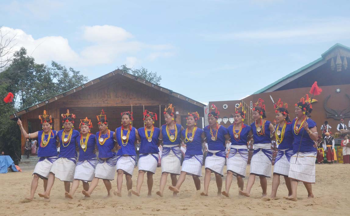 Artist from Nagaland erform a cultural dance on the second day of the state annual Hornbill Festival at Naga Heritage village Kisama, some 15 kms away from Kohima, Nagaland on Friday, December 02, 2016. Photo by Caisii Mao