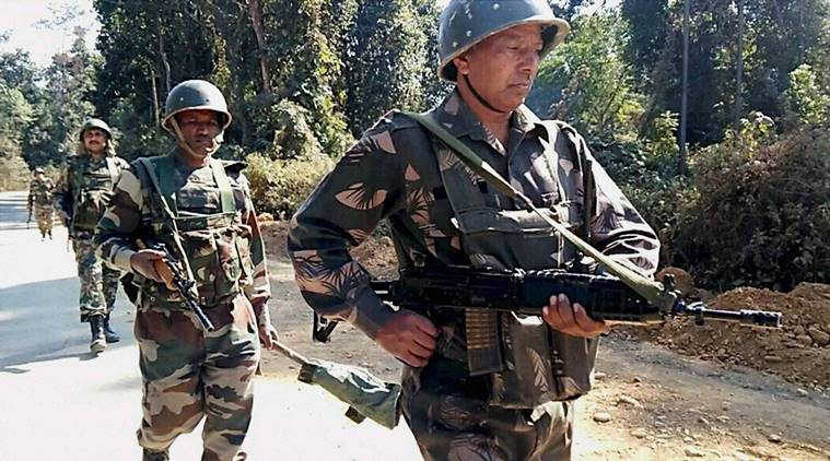 Tinsukia: Security men carrying out a search operation near the site of a militant attack at NH 153 where 2 Assam Rifles troopers were killed and three others injured, near Jagun in Tinsukia district, Assam on Monday. PTI Photo (PTI1_23_2017_000156B)