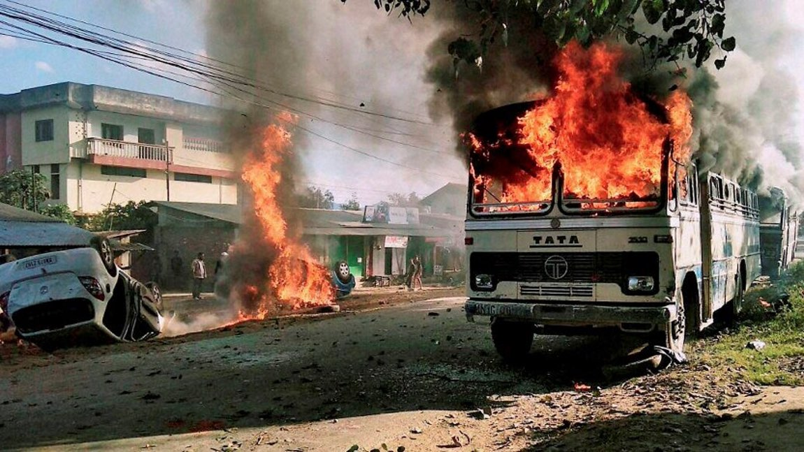 Angry mobs set vehicles on fire in Imphal East district on Sunday in protest against the United Naga Council's indefinite economic blockade. (Photo: PTI)