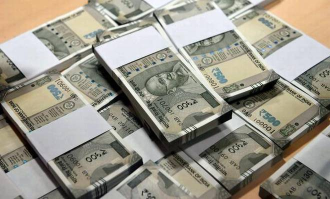 The Budget proposes to levy penalty on a person who receives ₹3 lakh and above.   | Photo Credit: PTI